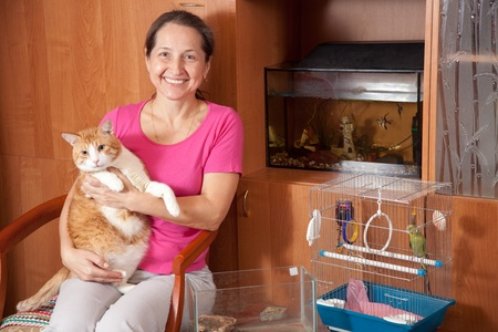 Happy  woman   with  pets in home photo