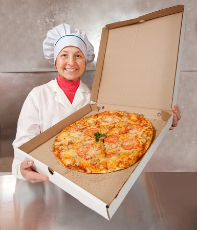 female cook with cooked pizza in box  photo