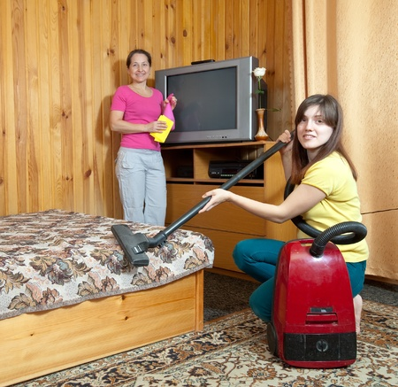 mother and adult daughter are doing house cleaning Stock Photo - 13064953