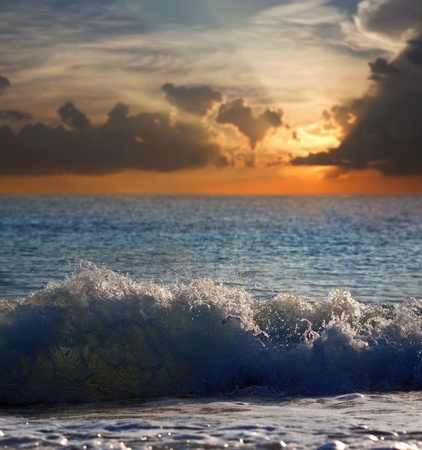 Sea wave during storm in sunset time photo