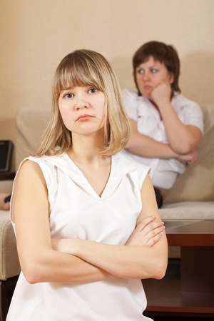 Two sad girls having conflict at home Stock Photo - 13086696