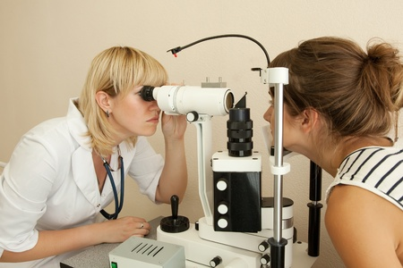 oculist and patient testing  eyesight  in clinic photo