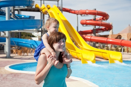 happy mother with  toddler at aquapark photo