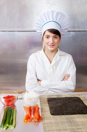 Cook woman with Ingredients for making sushi rolls photo