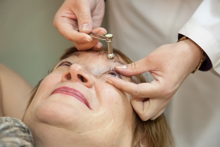 ocular: Ophthalmologist measures the  ocular tension in patients Stock Photo