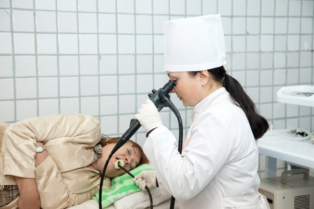 Doctor and patient during endoscopy exam in clinic photo