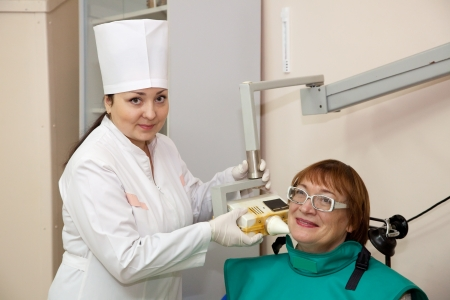 doctor makes a woman an x-ray of the tooth Stock Photo - 13119874