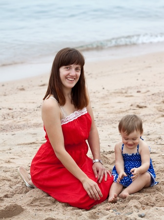 Happy mother with  toddler plays on sand beach Stock Photo - 13151663