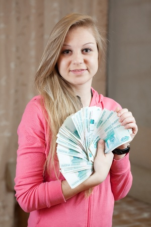 happy casual girl with many  roubles  in home interior photo