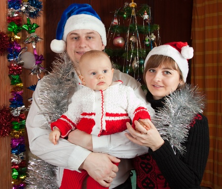 Family of three posing for  Christmas portrait at home Stock Photo - 13151848