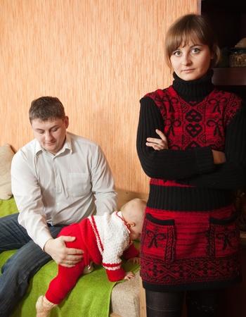 Family of three having quarrel at home photo