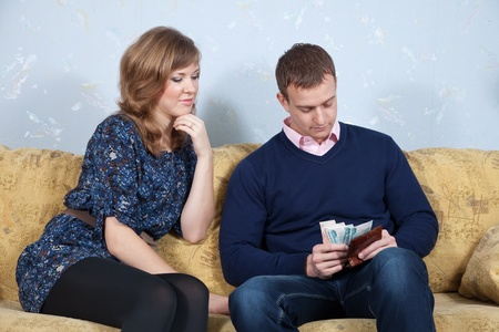 parsimony: husband and wife having a financial problems