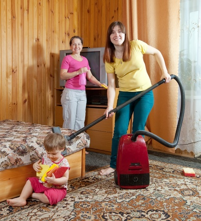 Family is cleans living room with vacuum cleaner  Stock Photo - 13200896