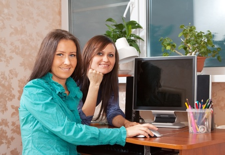 Two women using PC in office or home Stock Photo - 13200907