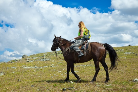 lone rider on horseback at mountains photo