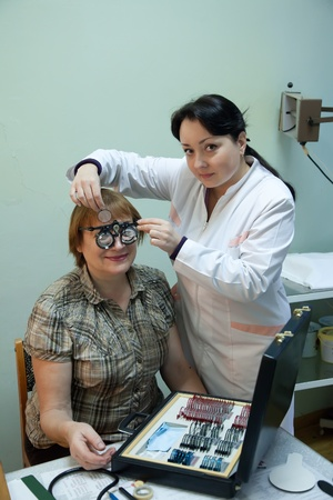 doctor of optometry: ophthalmologist  and patient testing  eyesight  in clinic