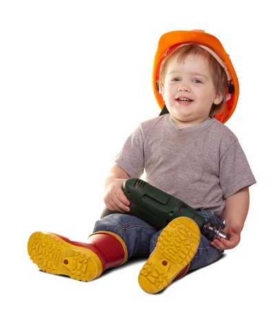 Toddler in hardhat with drill. Isolated over white background  with shade photo