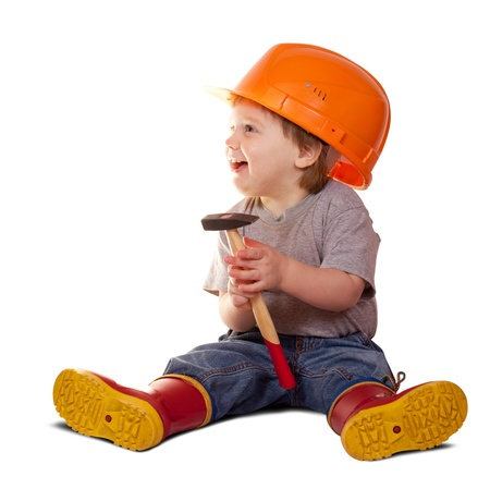 Toddler in hardhat with hammer. Isolated over white background  with shade Stock Photo - 13201249