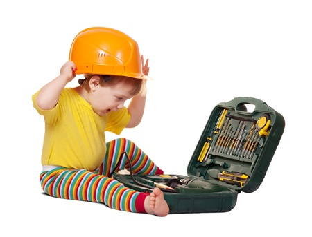 Toddler in hardhat with tool box. Isolated over white background with shade photo