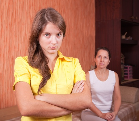 angry teenager: Mother and teen daughter having quarrel at home