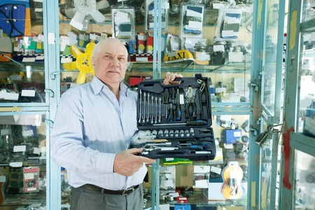 mature man buys  automotive  tool set in  auto parts store Stock Photo - 13238771