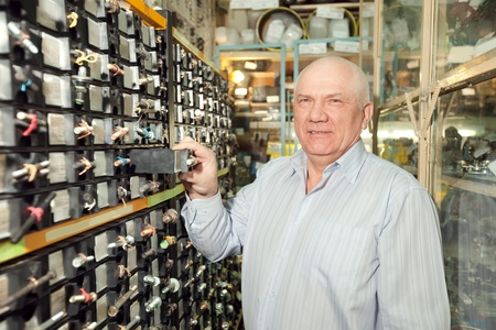 mature man chooses fasteners in  auto parts store Stock Photo - 13238748