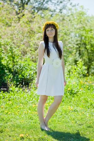 Full length shot of girl in dandelion wreath photo