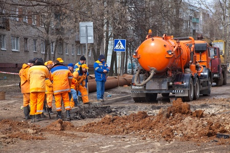 VLADIMIR, RUSSIA - APRIL 19:  Emergency repairs on April 19, 2012 in Vladimir, Russia. City service and rescuers do emergency repair work on damage caused by meltwater.Damaged sewer and water supply Stock Photo - 13256766