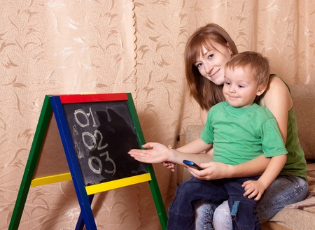 mothering: Mother teaches child to emergency phone numbers Stock Photo