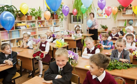 VLADIMIR, RUSSIA - SEPTEMBER 1: Day of Knowledge. First day in school. September 1, 2011 in Vladimir, Russia.Schoolchildren in their first lesson in school ¹ 36, now school has 1738 pupils Stock Photo - 13267010