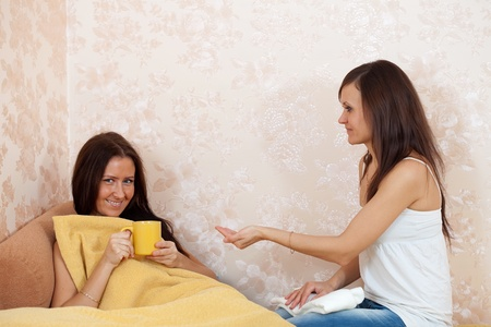 nursing sister: woman cares for a sick friend in home