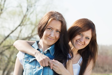 Two happy women together against sky Stock Photo - 13306001