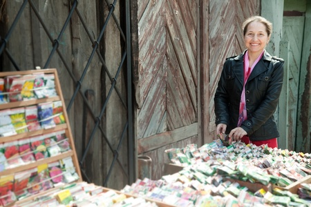 Mature woman buys the seeds on the market photo