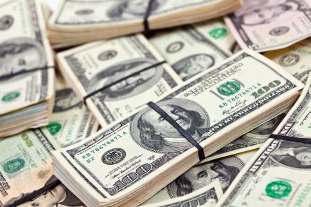 달러: 미국 달러 지폐의 많은 번들 스톡 사진