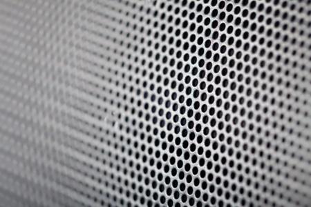 metal hole background (Closeup of speaker) photo
