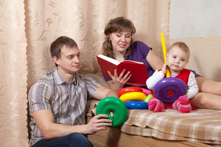 Family  relaxing at home on sofa Stock Photo - 13394898