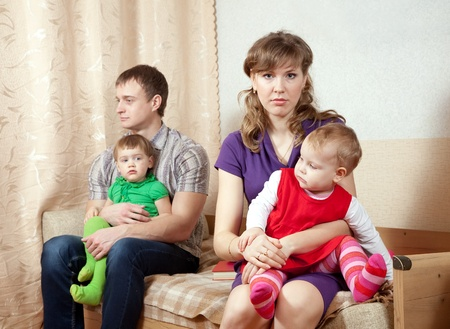 Family of four having quarrel at home photo