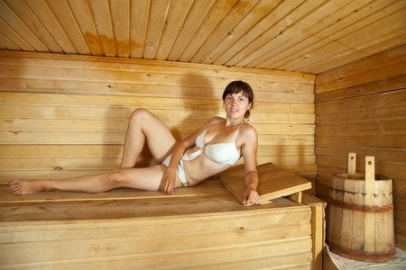 girl lying on  wooden bench in  sauna Stock Photo - 13453800