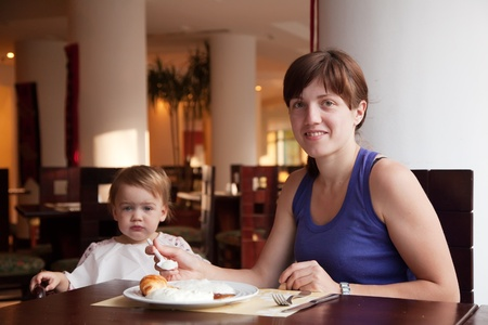 Family  having breakfast in hotel restaurant photo