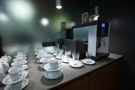 stainless steel pot:  coffee machine and mugs in bar