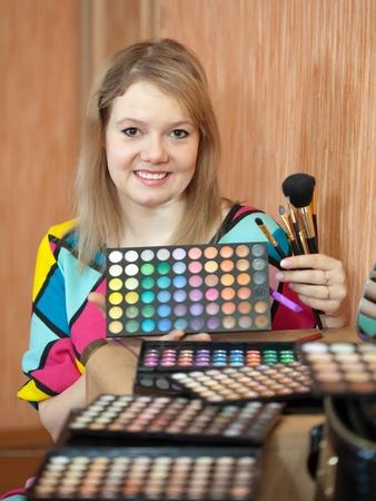 visagiste: Female visagiste with cosmetics ready for job