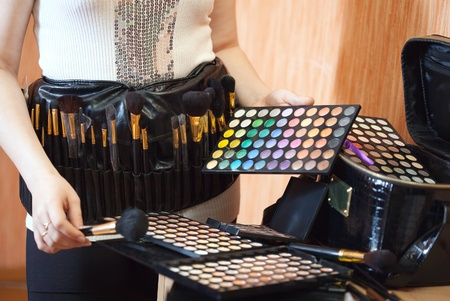 Close up of female visagiste with cosmetics ready for job Stock Photo - 13453786