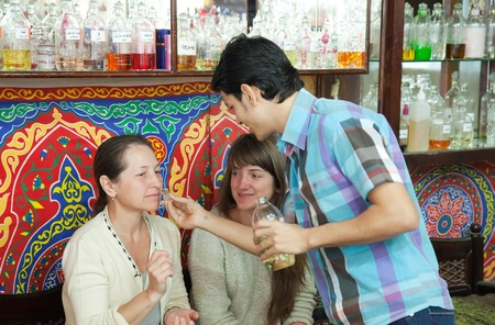 attar: HURGHADA, EGYPT - DECEMBER 30:   Salesman shows essential oils  on December 30, 2011 in Hurghada, Egypt.In  XV century were known essential oils of lavender, rose, sage. In the XVI - XVII centuries essential oils were obtained from more than 120 plants an