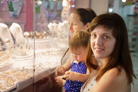 Women with child  looking jewelry  counter photo