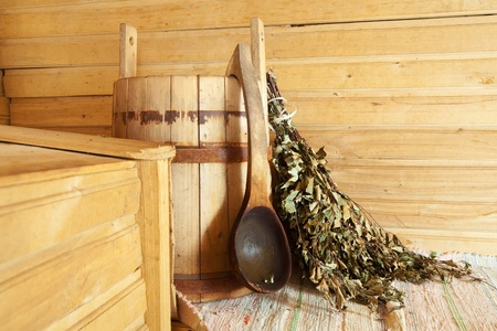 Flag broom on wooden bench  in interior of sauna   photo