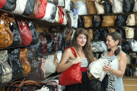 Two women chooses leather bag at  shop Stock Photo - 14757951
