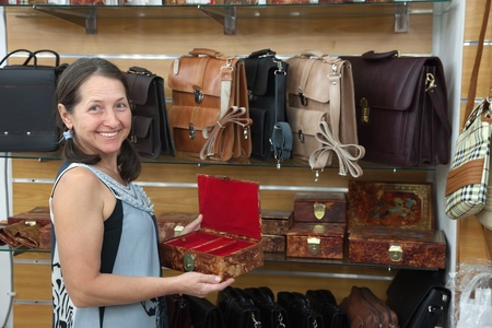 Mature woman chooses leather chest at  shop Stock Photo - 13550111