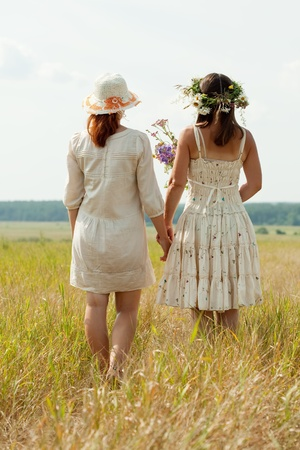 Rear view of two women in summer field photo