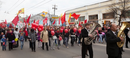 VLADIMIR, RUSSIA - MAY 1: Citizens are participating in the march of International Workers' Day event May 1, 2012 in Vladimir, Russia.Workers and opposition group walks in main street Stock Photo - 13575238
