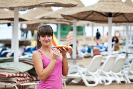 girl eating hot dog at the resort photo